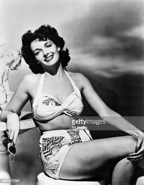 Jane Russell the girl whose curves and lowcut blouses have caused censorship trouble throughout the United States has cost producer Howard Hughes...