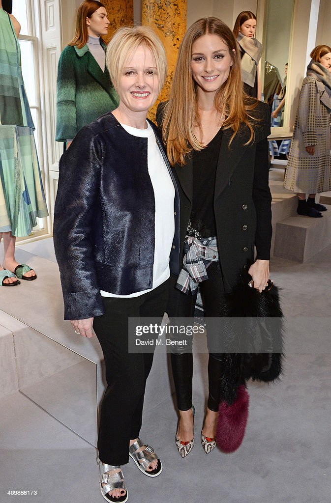 Jane Shepherdson (L), CEO of Whistles, and Olivia Palermo attend the Whistles presentation at London Fashion Week AW14 at 33 Fitzroy Place on February 17, 2014 in London, England.