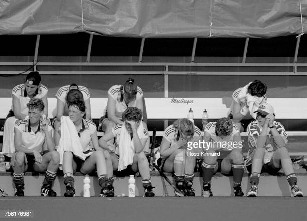 Jane Sixsmith Mandy Davies Rhona Simpson and members of the Great Britain Women's field hockey team show their emotion and disappointment after...