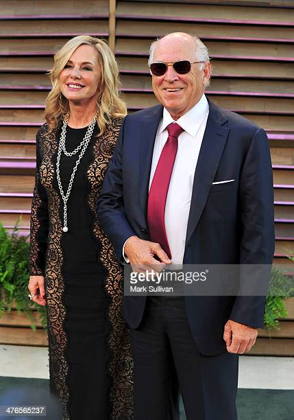 Jane Slagsvol and musician Jimmy Buffett attend the 2014 Vanity Fair Oscar Party hosted by Graydon Carter on March 2 2014 in West Hollywood California