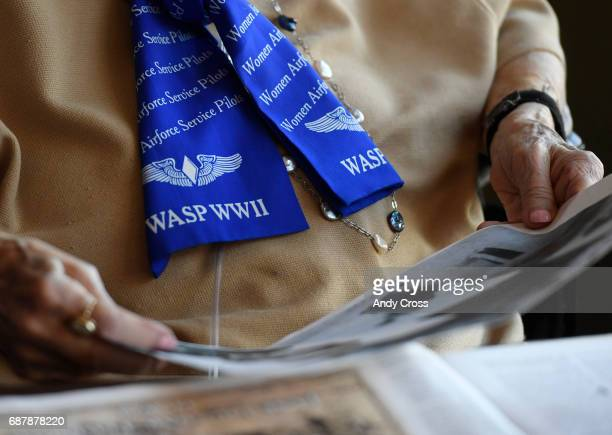 Jane Tedeschi wears a WASP scarf while looking through WWII memorabilia at the Brookdale Park Place senior housing community May 24 2017 in Denver...