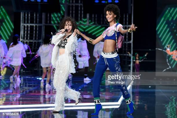 Jane Zhang and Samile Bermannelli walk the runway during the 2017 Victoria's Secret Fashion Show In Shanghai at MercedesBenz Arena on November 20...