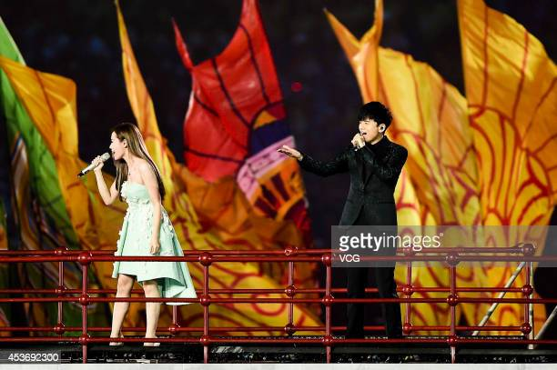 Jane Zhang and Zhang Jie perform during the opening ceremony for the Nanjing 2014 Summer Youth Olympic Games at the Nanjing Olympic Sports Centre on...