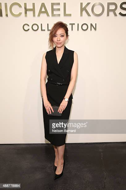 Jane Zhang poses backstage at the Michael Kors Spring 2016 Runway Show during New York Fashion Week The Shows at Spring Studios on September 16 2015...