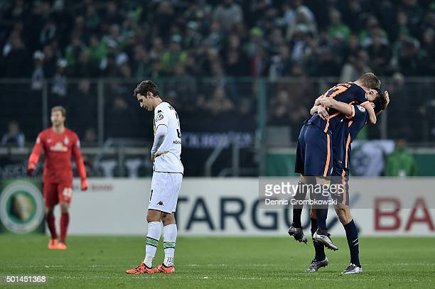 Janek Sternberg and Santiago Garcia of Werder Bremen celebrate after the DFB Cup Round of 16 match between Borussia Moenchengladbach and Werder...