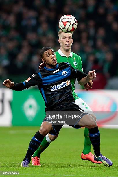 Janek Sternberg of Bremen and Elias Kachunga of Paderborn compete for the ball during the First Bundesliga match between SV Werder Bremen and SC...