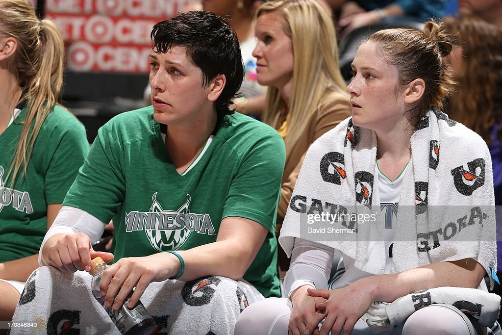 Janel McCarville #4 and Lindsay Whalen #13 of the Minnesota Lynx focus on watching their team play against the San Antonio Silver Stars during the WNBA game on June 11, 2013 at Target Center in Minneapolis, Minnesota.