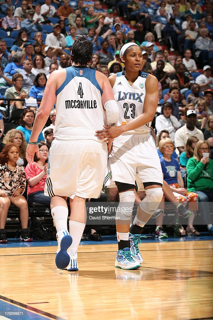 Janel McCarville #4 and Maya Moore #23 celebrate after a play against the San Antonio Silver Stars during the WNBA game on June 11, 2013 at Target Center in Minneapolis, Minnesota.