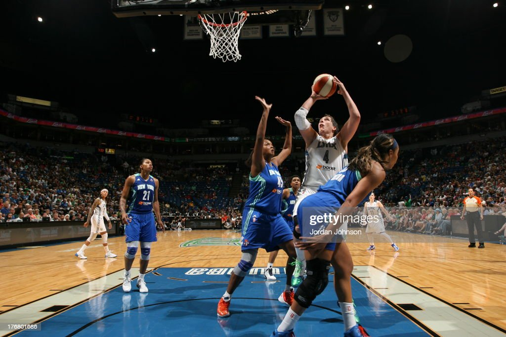 <a gi-track='captionPersonalityLinkClicked' href=/galleries/search?phrase=Janel+McCarville&family=editorial&specificpeople=239106 ng-click='$event.stopPropagation()'>Janel McCarville</a> #4 Minnesota Lynx shoots against Kara Braxton #45 and Plenette Pierson #33 of the New York Liberty during the WNBA game on August 18, 2013 at Target Center in Minneapolis, Minnesota.
