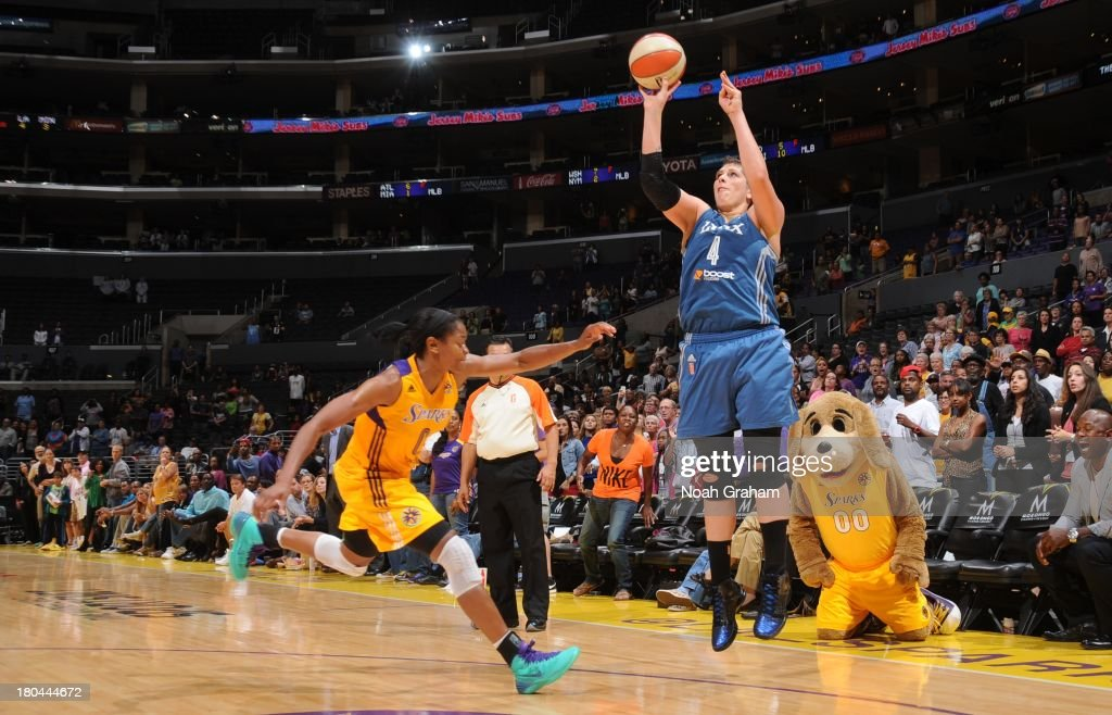 <a gi-track='captionPersonalityLinkClicked' href=/galleries/search?phrase=Janel+McCarville&family=editorial&specificpeople=239106 ng-click='$event.stopPropagation()'>Janel McCarville</a> #4 of the Minnesota Lynx attempts a shot during a game against the Los Angeles Sparks at Staples Center on September 12, 2013 in Los Angeles, California.