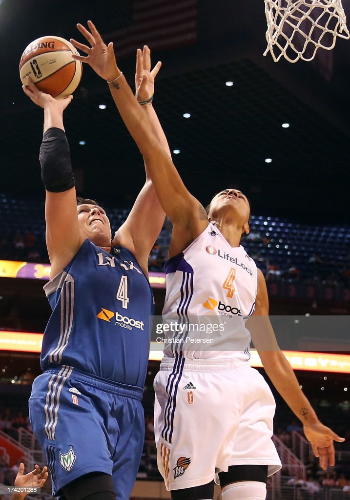 <a gi-track='captionPersonalityLinkClicked' href=/galleries/search?phrase=Janel+McCarville&family=editorial&specificpeople=239106 ng-click='$event.stopPropagation()'>Janel McCarville</a> #4 of the Minnesota Lynx attemtps a shot over <a gi-track='captionPersonalityLinkClicked' href=/galleries/search?phrase=Candice+Dupree&family=editorial&specificpeople=537818 ng-click='$event.stopPropagation()'>Candice Dupree</a> #4 of the Phoenix Mercury during the first half of the WNBA game at US Airways Center on July 21, 2013 in Phoenix, Arizona. The Lynx defeated the Mercury 82-77.