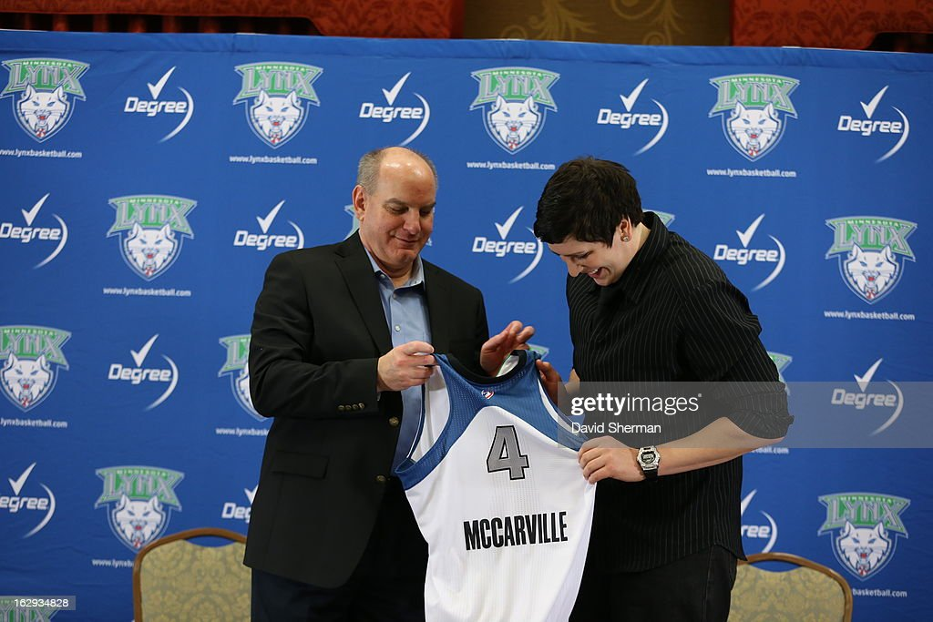 Janel McCarville of the Minnesota Lynx checks out her new jersey with Executive Vice President Roger Griffith during a press conference on March 1, 2013 at the Depot Renaissance Hotel in Minneapolis, Minnesota.