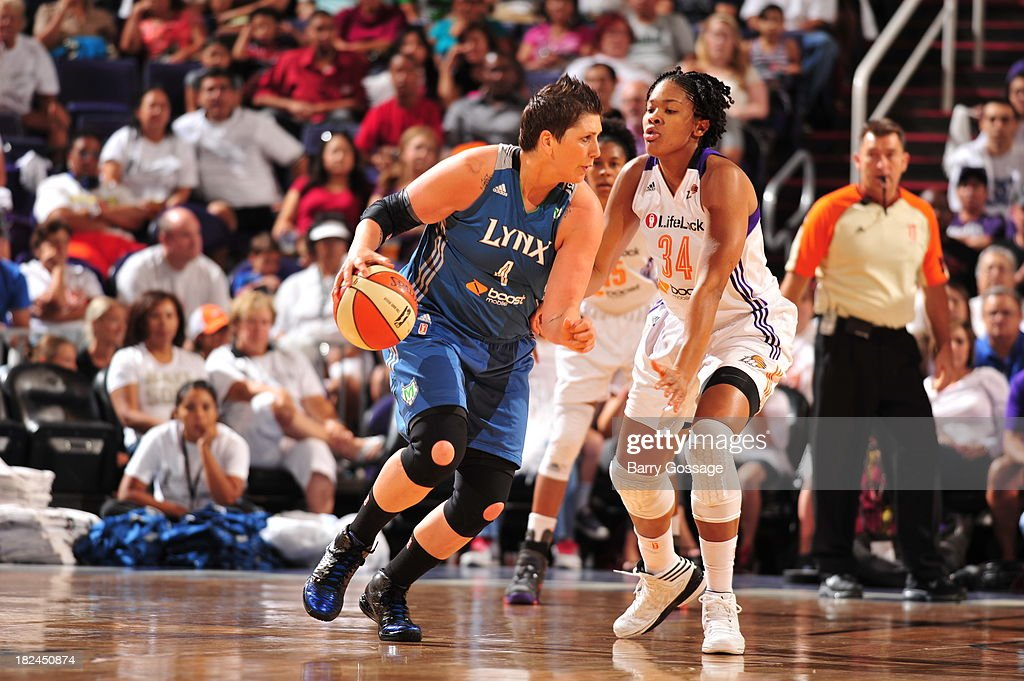 <a gi-track='captionPersonalityLinkClicked' href=/galleries/search?phrase=Janel+McCarville&family=editorial&specificpeople=239106 ng-click='$event.stopPropagation()'>Janel McCarville</a> #4 of the Minnesota Lynx dribbles against Krystal Thomas #34 of the Phoenix Mercury in Game 2 of the Western Conference Finals during 2013 WNBA Playoffs on September 29, 2013 at U.S. Airways Center in Phoenix, Arizona.