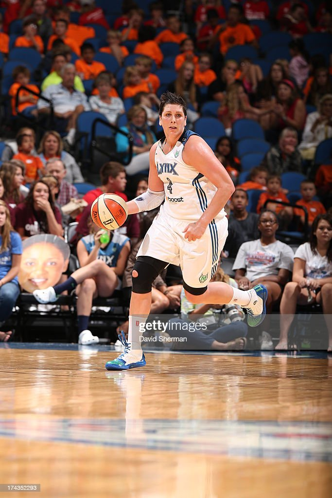 Janel McCarville #4 of the Minnesota Lynx dribbles against the Phoenix Mercury during the WNBA game on July 24, 2013 at Target Center in Minneapolis, Minnesota.