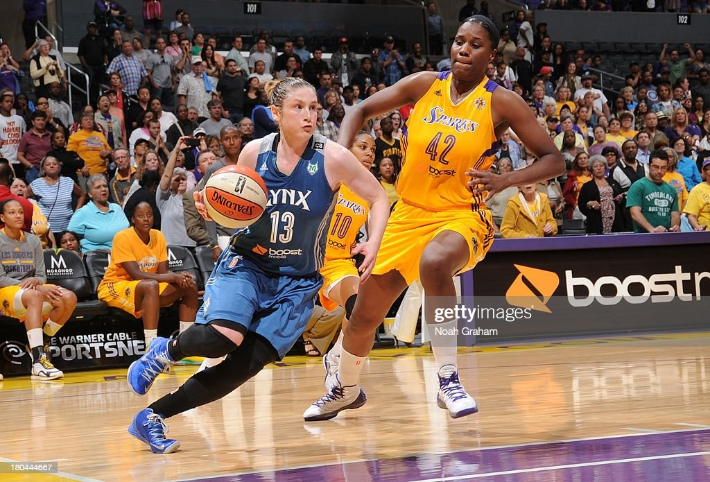 <a gi-track='captionPersonalityLinkClicked' href=/galleries/search?phrase=Janel+McCarville&family=editorial&specificpeople=239106 ng-click='$event.stopPropagation()'>Janel McCarville</a> #4 of the Minnesota Lynx drives to the basket during a game against the Los Angeles Sparks at Staples Center on September 12, 2013 in Los Angeles, California.