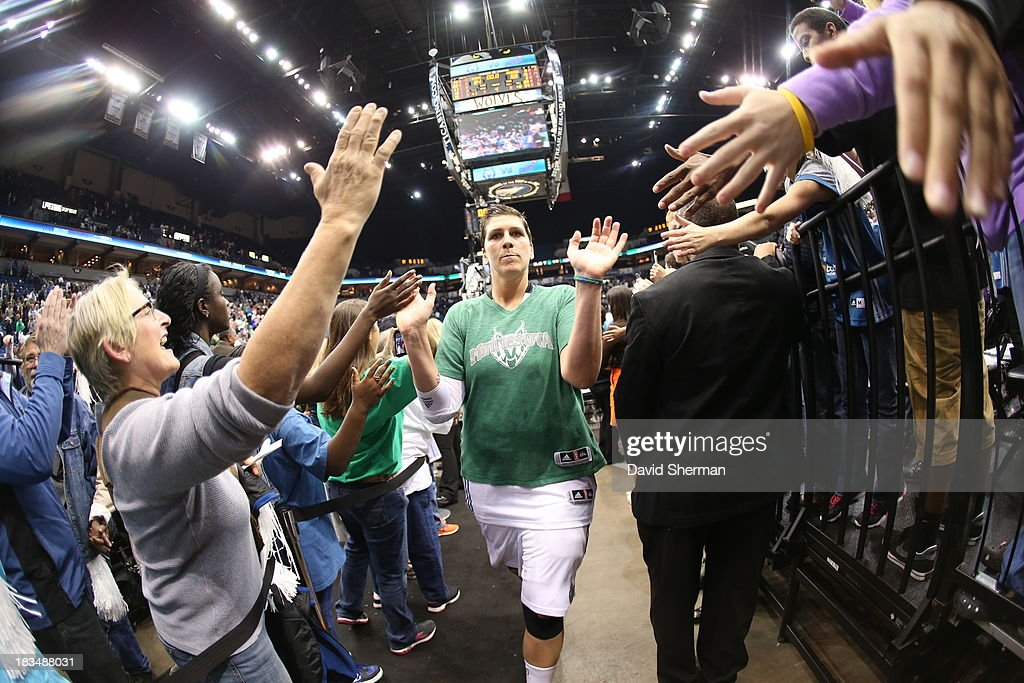 <a gi-track='captionPersonalityLinkClicked' href=/galleries/search?phrase=Janel+McCarville&family=editorial&specificpeople=239106 ng-click='$event.stopPropagation()'>Janel McCarville</a> #4 of the Minnesota Lynx gives fans high fives after the win against the Atlanta Dream after Game 1 of the 2013 WNBA Finals on October 6, 2013 at Target Center in Minneapolis, Minnesota.