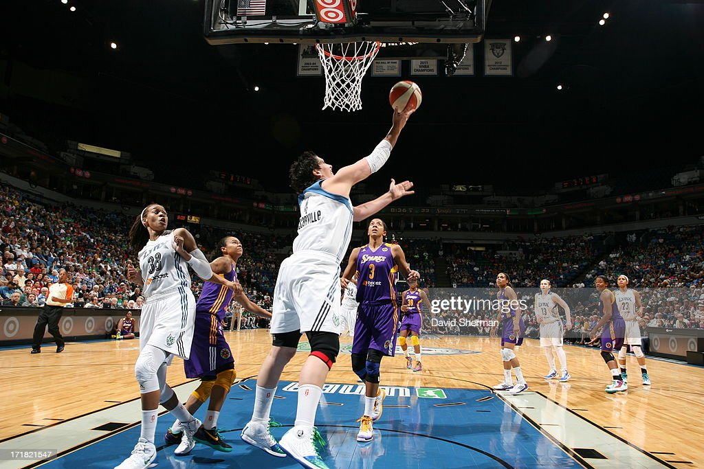 <a gi-track='captionPersonalityLinkClicked' href=/galleries/search?phrase=Janel+McCarville&family=editorial&specificpeople=239106 ng-click='$event.stopPropagation()'>Janel McCarville</a> #4 of the Minnesota Lynx goes for a reverse layup <a gi-track='captionPersonalityLinkClicked' href=/galleries/search?phrase=Candace+Parker&family=editorial&specificpeople=752955 ng-click='$event.stopPropagation()'>Candace Parker</a> #3 of the the Los Angeles Sparks during the WNBA game on June 28, 2013 at Target Center in Minneapolis, Minnesota.