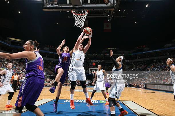 Janel McCarville of the Minnesota Lynx goes for the rebound against Brittney Griner of the Phoenix Mercury during the WNBA Western Conference Finals...