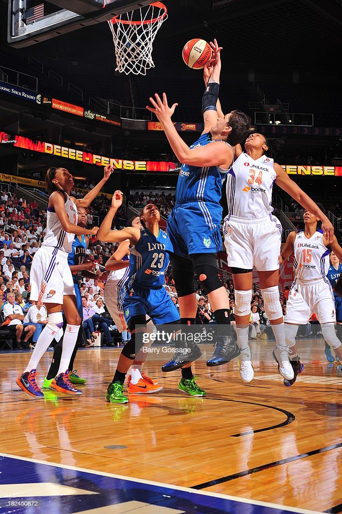 Janel McCarville #4 of the Minnesota Lynx grabs a rebound against Krystal Thomas #34 of the Phoenix Mercury in Game 2 of the Western Conference Finals during 2013 WNBA Playoffs on September 29, 2013 at U.S. Airways Center in Phoenix, Arizona.