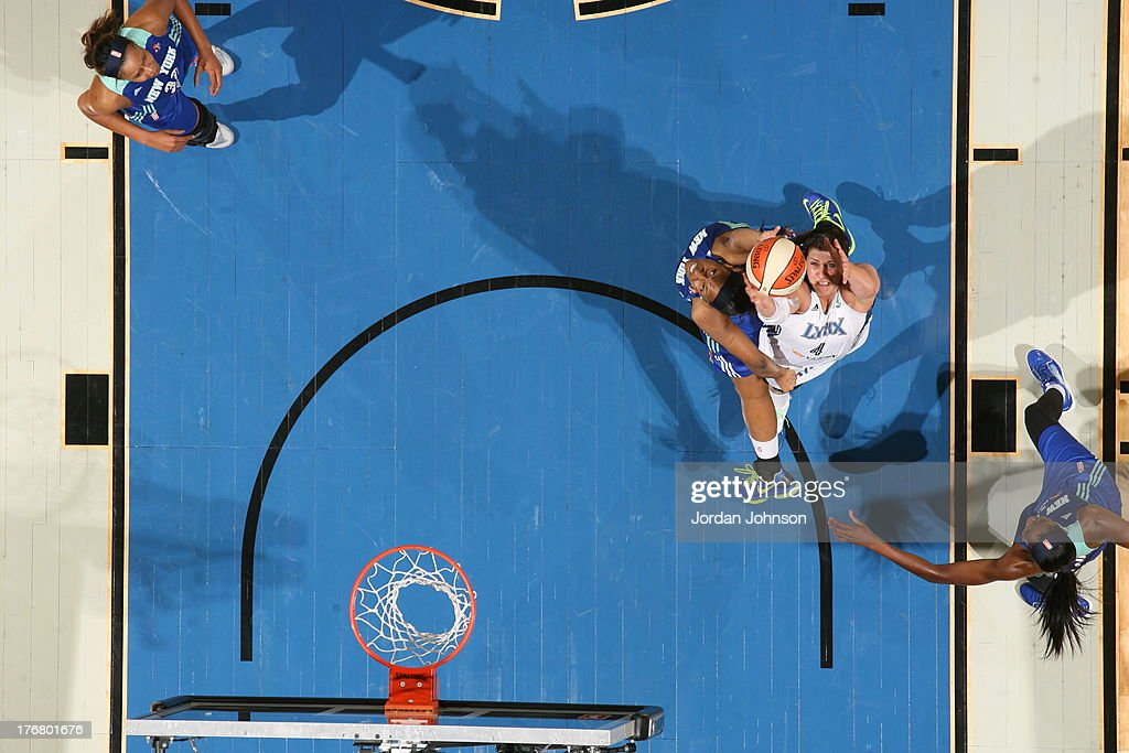 <a gi-track='captionPersonalityLinkClicked' href=/galleries/search?phrase=Janel+McCarville&family=editorial&specificpeople=239106 ng-click='$event.stopPropagation()'>Janel McCarville</a> #4 of the Minnesota Lynx rebounds against <a gi-track='captionPersonalityLinkClicked' href=/galleries/search?phrase=Kelsey+Bone&family=editorial&specificpeople=5792056 ng-click='$event.stopPropagation()'>Kelsey Bone</a> #3 of the New York Liberty during the WNBA game on August 18, 2013 at Target Center in Minneapolis, Minnesota.