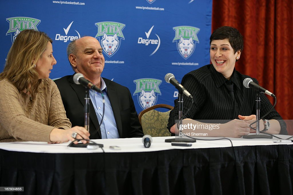 Janel McCarville of the Minnesota Lynx shares a laugh with Executive Vice President Roger Griffith and Head Coach Cheryl Reeve during a press conference on March 1, 2013 at the Depot Renaissance Hotel in Minneapolis, Minnesota.