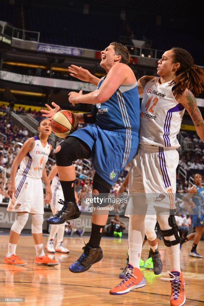 <a gi-track='captionPersonalityLinkClicked' href=/galleries/search?phrase=Janel+McCarville&family=editorial&specificpeople=239106 ng-click='$event.stopPropagation()'>Janel McCarville</a> #4 of the Minnesota Lynx shoots against <a gi-track='captionPersonalityLinkClicked' href=/galleries/search?phrase=Brittney+Griner&family=editorial&specificpeople=6836945 ng-click='$event.stopPropagation()'>Brittney Griner</a> #42 of the Phoenix Mercury in Game 2 of the Western Conference Finals during 2013 WNBA Playoffs on September 29, 2013 at U.S. Airways Center in Phoenix, Arizona.