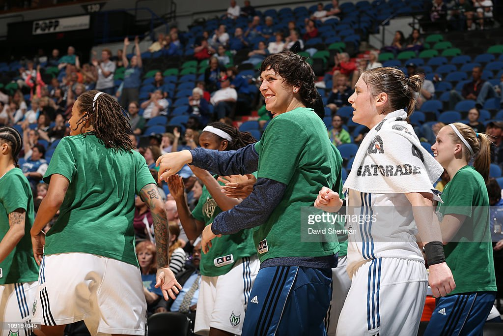 Janel Mccarville #4 of the Minnesota Lynx smiles during the WNBA pre-season game against the Connecticut Sun on May 21, 2013 at Target Center in Minneapolis, Minnesota.
