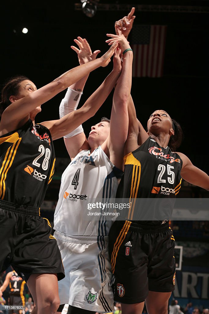 <a gi-track='captionPersonalityLinkClicked' href=/galleries/search?phrase=Janel+McCarville&family=editorial&specificpeople=239106 ng-click='$event.stopPropagation()'>Janel McCarville</a> #4 of the Minnesota Lynx struggles to shoot against <a gi-track='captionPersonalityLinkClicked' href=/galleries/search?phrase=Nicole+Powell&family=editorial&specificpeople=217548 ng-click='$event.stopPropagation()'>Nicole Powell</a> #28 and Glory Johnson #25 of the the Tulsa Shock during the WNBA game on June 23, 2013 at Target Center in Minneapolis, Minnesota.