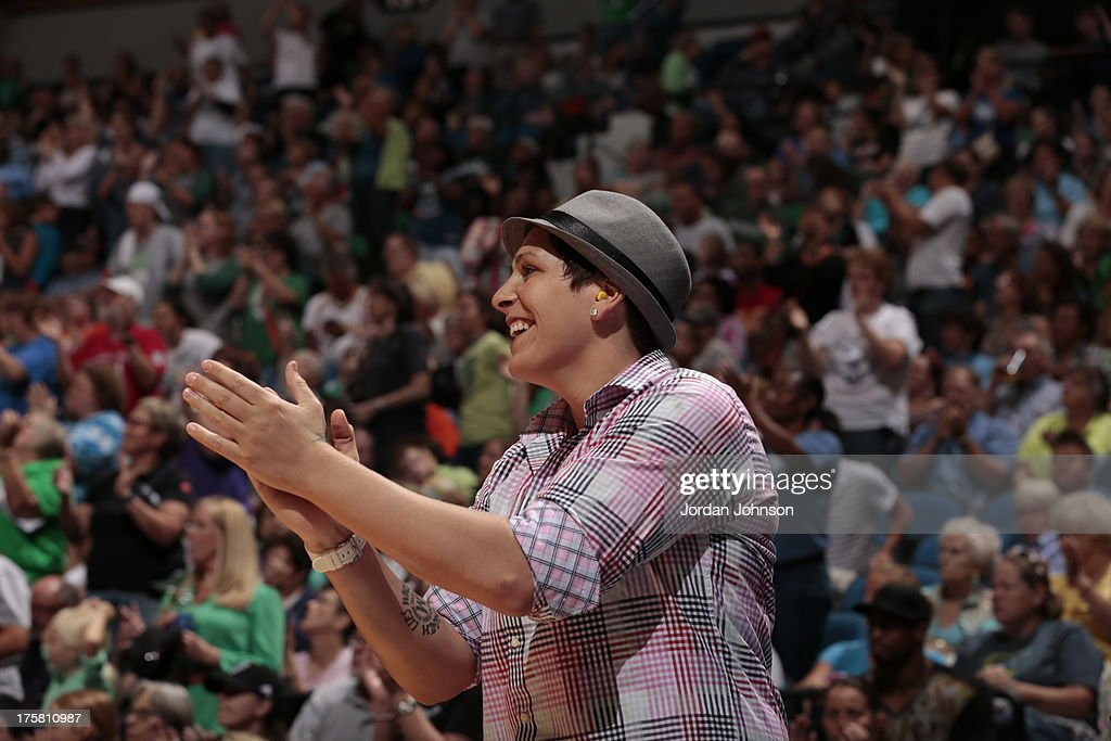<a gi-track='captionPersonalityLinkClicked' href=/galleries/search?phrase=Janel+McCarville&family=editorial&specificpeople=239106 ng-click='$event.stopPropagation()'>Janel McCarville</a> #4 of the Minnesota Lynx supports her teammates during the WNBA game against the Washington Mystics on August 8, 2013 at Target Center in Minneapolis, Minnesota.