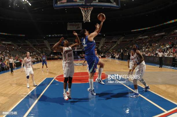 Janel McCarville of the New York Liberty puts up a reverse layup against Alexis Hornbuckle of the Detroit Shock on August 4 2009 at The Palace of...