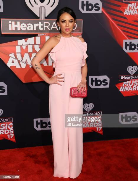 Janel Parrish attends the 2017 iHeartRadio Music Awards at The Forum on March 5 2017 in Inglewood California