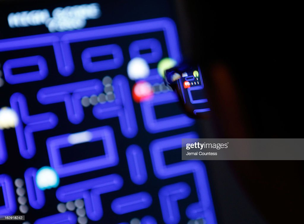 Janelle Grace plays 'Pac-Man' which is one of the 14 video games that are part of the exhibiton 'Applied Designs' during the 'Applied Design' press preview at The Museum of Modern Art on March 1, 2013 in New York City.