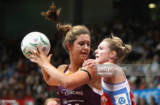 Janelle Lawson of the Firebirds secures the ball during the round seven ANZ Championships match between the Sydney Swifts and the Queensland...