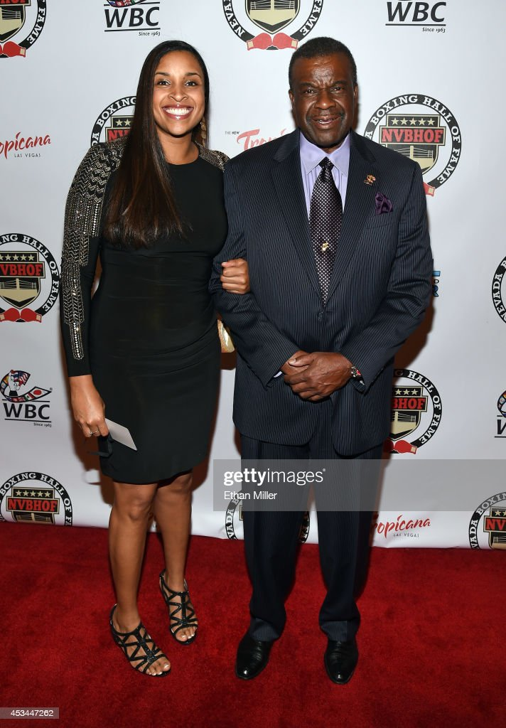 Janelle Mack (L) and her father, inductee Luther Mack arrive at the second annual Nevada Boxing Hall of Fame induction gala at the New Tropicana Las Vegas on August 9, 2014 in Las Vegas, Nevada.