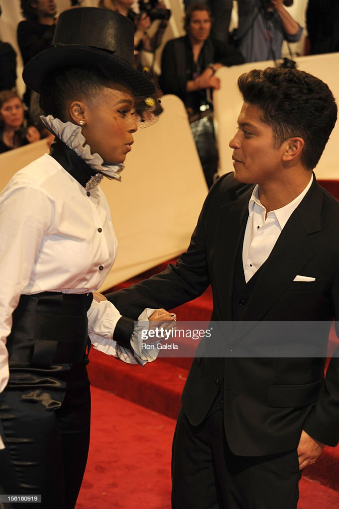 Janelle Monae and Bruno Mars attend 'Alexander McQueen: Savage Beauty' Costume Institute Gala on April 2, 2011 at the Metropolitan Museum of Art in New York City.