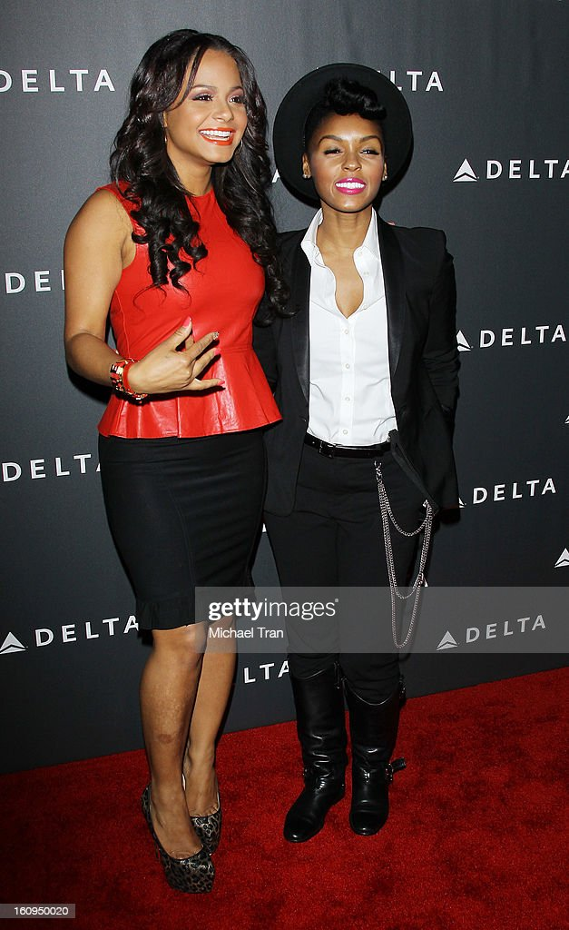 <a gi-track='captionPersonalityLinkClicked' href=/galleries/search?phrase=Janelle+Monae&family=editorial&specificpeople=715847 ng-click='$event.stopPropagation()'>Janelle Monae</a> and <a gi-track='captionPersonalityLinkClicked' href=/galleries/search?phrase=Christina+Milian&family=editorial&specificpeople=171274 ng-click='$event.stopPropagation()'>Christina Milian</a> arrive at Delta Air Lines celebrates the GRAMMY Awards held at The Getty House on February 7, 2013 in Los Angeles, California.