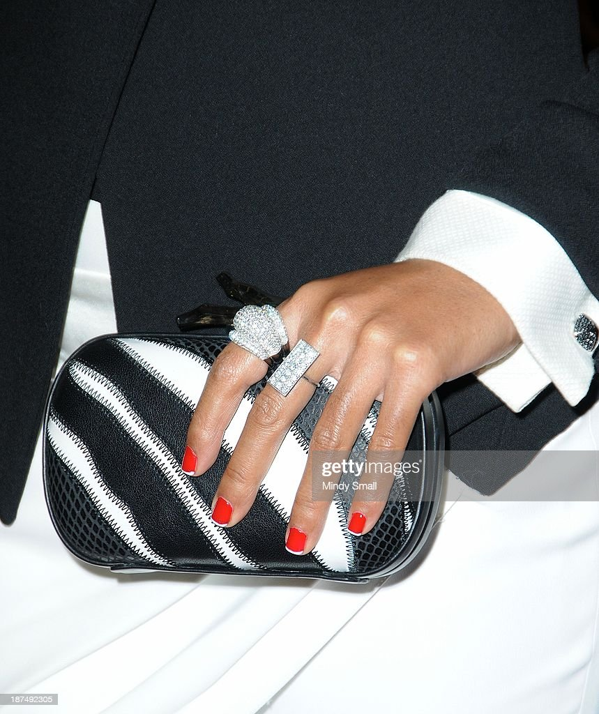 <a gi-track='captionPersonalityLinkClicked' href=/galleries/search?phrase=Janelle+Monae&family=editorial&specificpeople=715847 ng-click='$event.stopPropagation()'>Janelle Monae</a> (handbag and jewelry detail) arrives at the Soul Train Awards 2013 at the Orleans Hotel & Casino on November 8, 2013 in Las Vegas, Nevada.