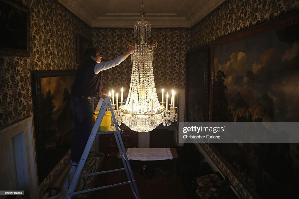 Janet Bitton Assistant House Keeper at Chatsworth House deep cleans a regency cut glass chandlier at the historic stately home on December 18, 2012 in Chatsworth, England. The Derbyshire stately home of the Duke and Duchess of Devonshire is currently undergoing it's annual deep clean and conservation work on the second floor. The historic house has over 300 rooms, 17 staircases, 459 windows and requires an army of specialists to keep it in pristine condition. The conservation work continues through the winter and is completed by 10th March when the house fully re-opens.