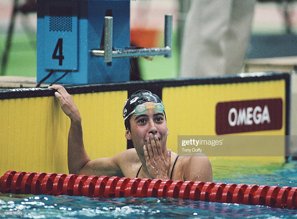 Janet Evans of the United States celebrates winning the Women's 400 metres Freestyle final on 22nd September 1988 during the XXIV Summer Olympic Games at the Jamsil Indoor Swimming Pool in Seoul, South Korea.