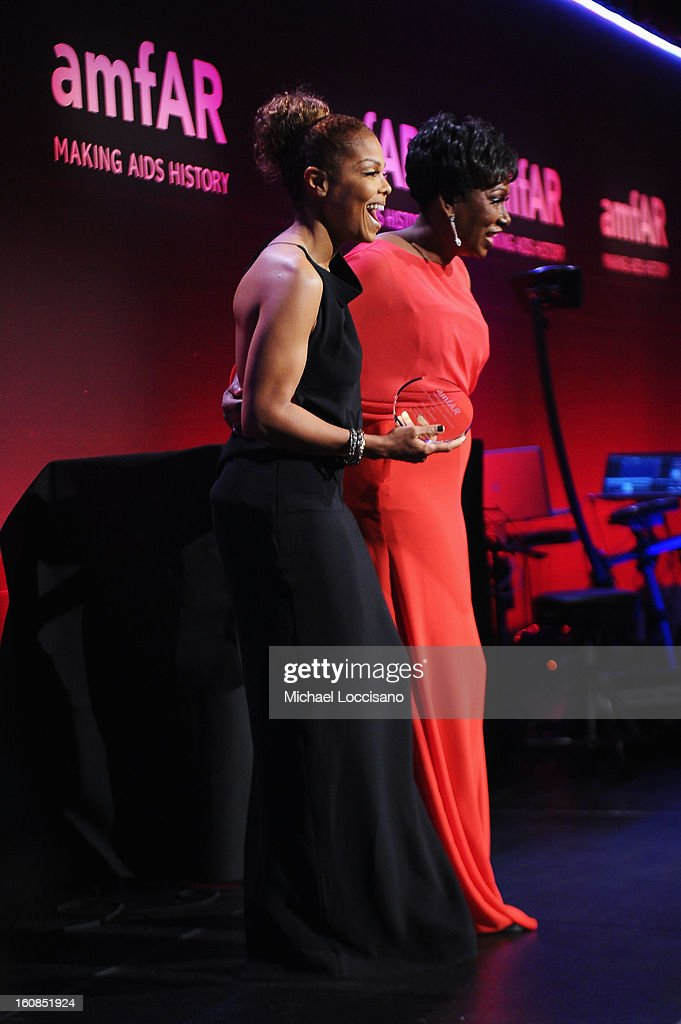 Janet Jackson and Maria Davis onstage at the amfAR New York Gala to kick off Fall 2013 Fashion Week at Cipriani Wall Street on February 6, 2013 in New York City.