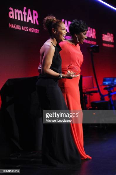 Janet Jackson and Maria Davis onstage at the amfAR New York Gala to kick off Fall 2013 Fashion Week at Cipriani Wall Street on February 6 2013 in New...