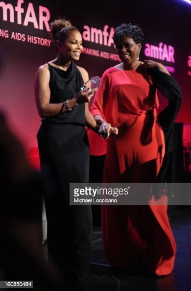 Janet Jackson and Maria Davis speak onstage at the amfAR New York Gala to kick off Fall 2013 Fashion Week at Cipriani Wall Street on February 6 2013...