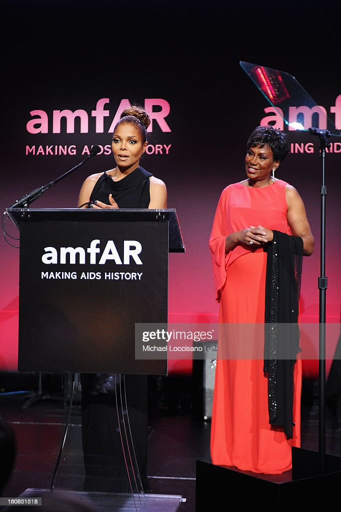 Janet Jackson (L) and Maria Davis speak onstage at the amfAR New York Gala to kick off Fall 2013 Fashion Week at Cipriani Wall Street on February 6, 2013 in New York City.