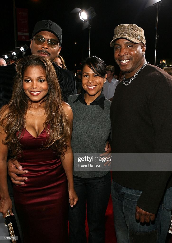 Janet Jackson poses with Tyler Perry, Barry Bonds and Liz Watson at Lionsgate's Premiere Of 'Why Did I Get Married?' held at the The Cinerama Dome, Arclight Hollywood on October 4, 2007 in Los Angeles, California.