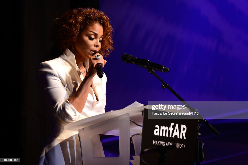 Janet Jackson speaks on stage as part of amfAR's 20th Annual Cinema Against AIDS during The 66th Annual Cannes Film Festival at Hotel du Cap-Eden-Roc on May 23, 2013 in Cap d'Antibes, France.