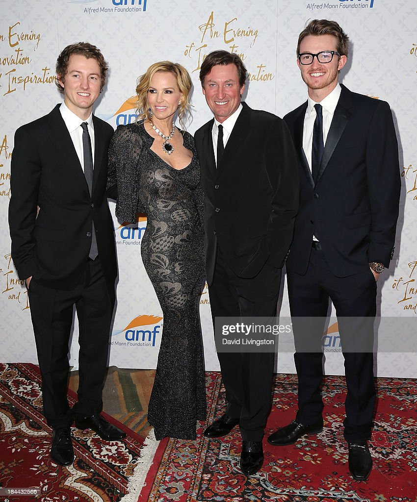 Janet Jones (2nd from L) and husband former NHL player Wayne Gretzky (3rd from L) and sons attend the 10th Annual Alfred Mann Foundation Gala in the Robinsons-May Lot on October 13, 2013 in Beverly Hills, California.