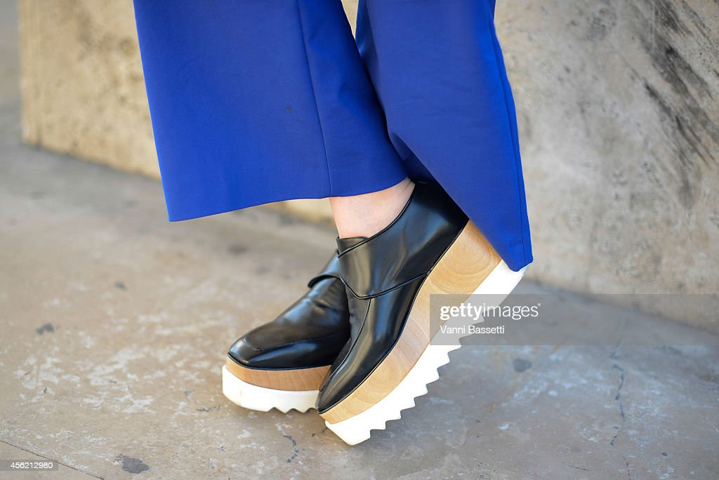 Janet Kseng poses wearing Zara pants and Stella McCartney shoes on September 27 2014 in Paris France