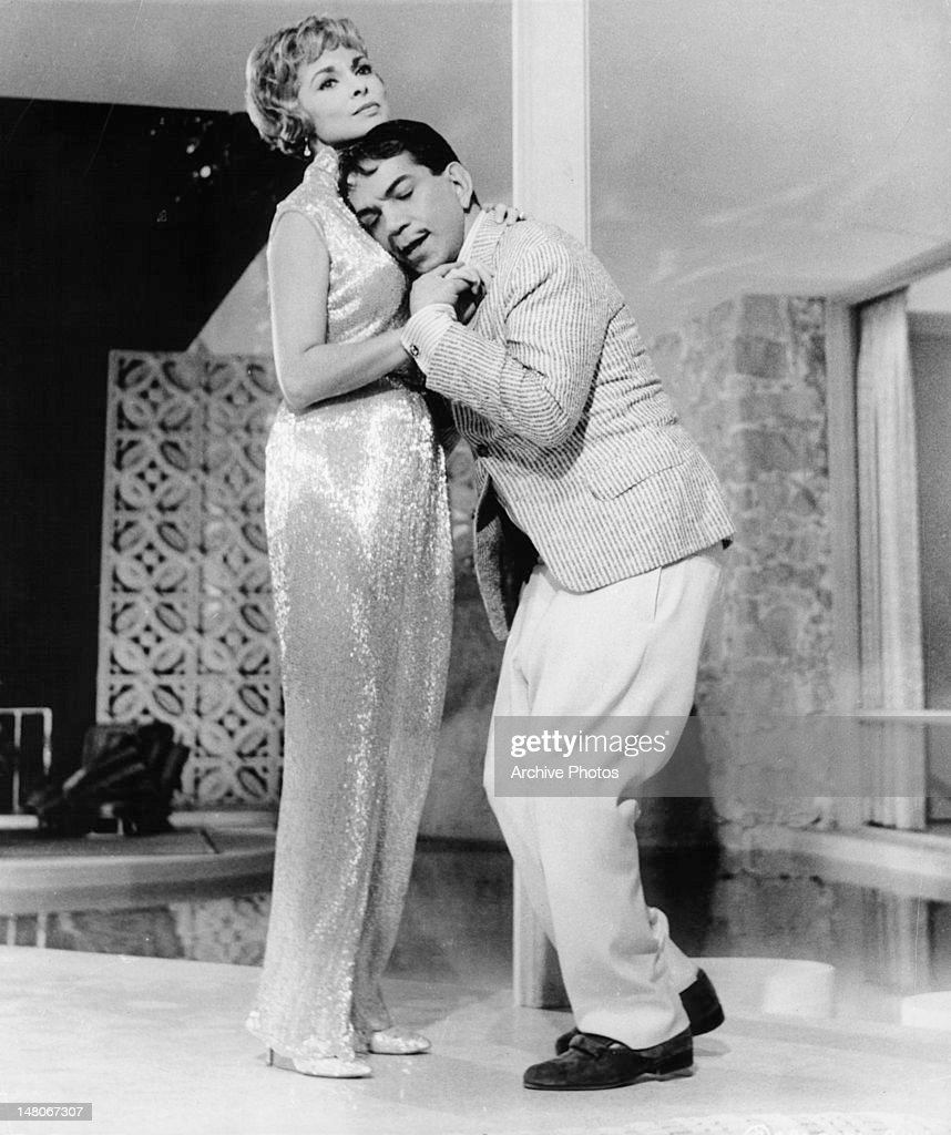 Janet Leigh dancing with Cantinflas in a scene from the film 'Pepe', 1960.