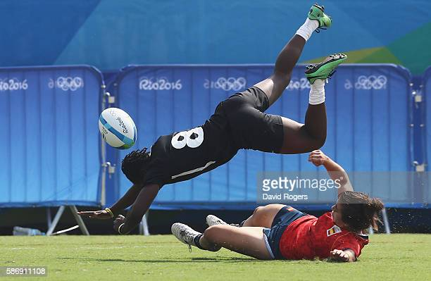 Janet Okelo of Kenya drives for a try attempt against Patricia Garcia of Spain during the Women's Pool B rugby match on Day 2 of the Rio 2016 Olympic...