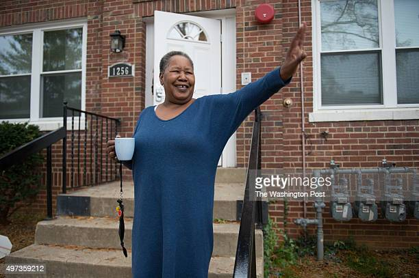 Janet Sharpe waves to a passing neighbor outside of her new home in Washington DC on Nov 2 2015 With the help of Open Arms Housing Incwomen like...